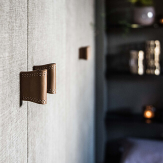 Leather closet handles in beige brown