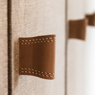 Leather furniture handle in beige brown on built-in wardrobe