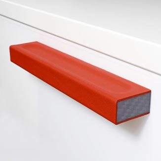 Cabinet pulls made of Carbon and red leather by minimaro